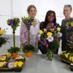 women with sucess in their flower design class